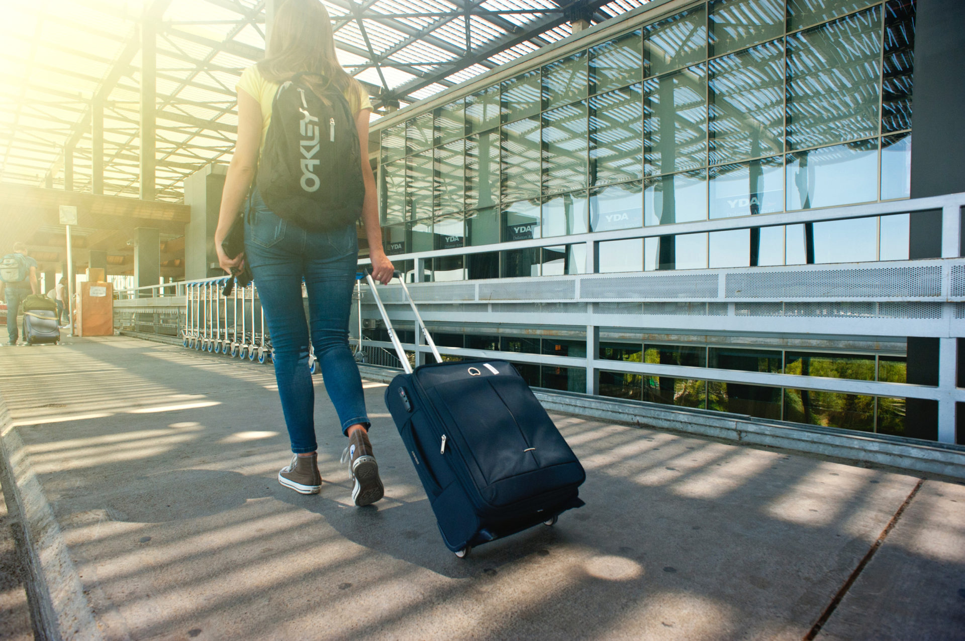 Girl with Traveling Bag on Airport